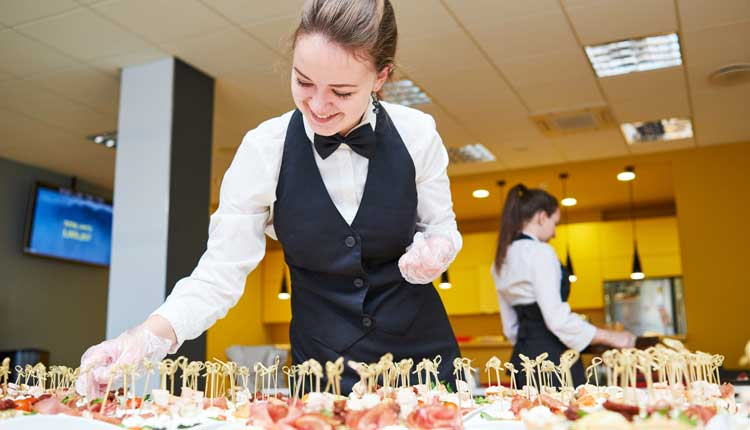 Restaurant specialist preparing a buffet