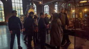 Group of Chinese teachers on a guided tour of the Chemnitz Industrial Museum