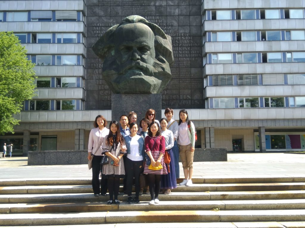"Group picture of the Sino-German-Eldercare-Project in front of the ""Karl-Marx""-monument"