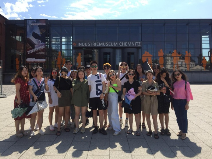 Group of students from Chongqing / China standing in front of the Industrial Museum