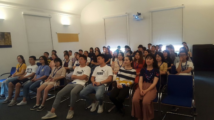 Group of students from Chongqing / China is sitting in the welcome room of the Nudelcenter Riesa