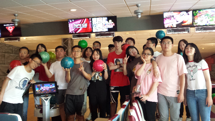 Group of students from Chongqing / China is standing in the Bowling Center