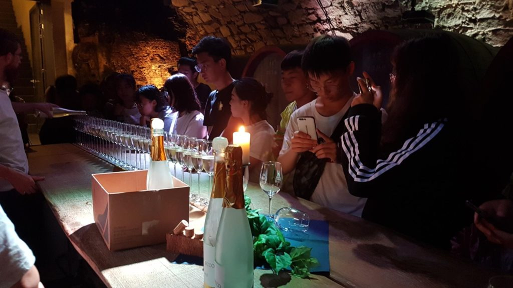 Students of the Shanxis Business Group during a wine tasting.